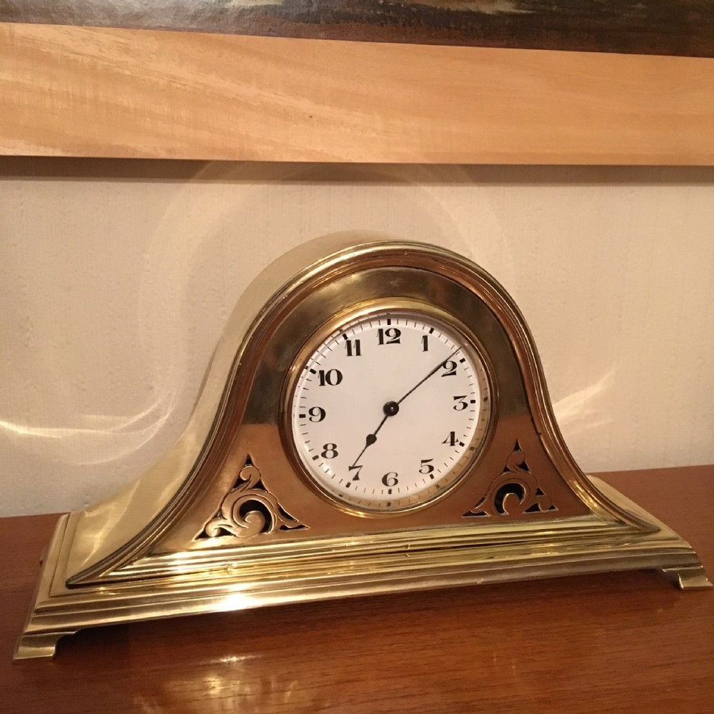brass cased mantel or shelf clock