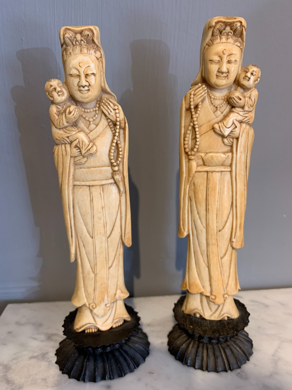 pair of carved ivory chinese figures
